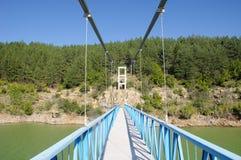 Rope pedestrian bridge on Kardzhali dam, Bulgaria Royalty Free Stock Photos