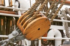 Rope pulley on ship. Rope pulley on old sailing ship Stock Photo