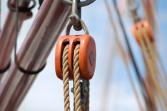 Rope pulley on sailboat. A closeup view of a rope pulley or tackle on a sailboat royalty free stock photography
