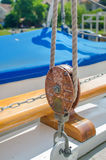 Rope Pulley On Sailboat. A closeup view of a rope pulley or tackle on a sailboat Royalty Free Stock Images