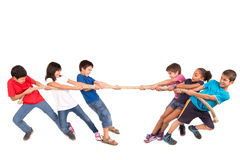 Rope pulling. Group of children in a rope-pulling contest Royalty Free Stock Images