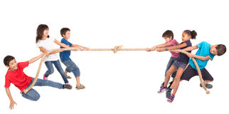 Rope pulling. Group of children in a rope-pulling contest Stock Image