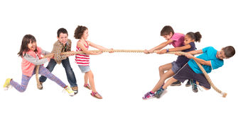 Rope pulling. Group of children in a rope-pulling contest Stock Photos