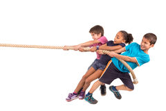 Rope pulling. Group of children in a rope-pulling contest Royalty Free Stock Photo
