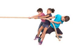 Rope pulling. Group of children in a rope-pulling contest Stock Photography