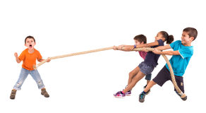 Rope pulling. Group of children in a rope-pulling contest against just one kid Royalty Free Stock Image
