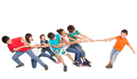 Rope pulling. Group of children in a rope-pulling contest against just one kid Stock Photos
