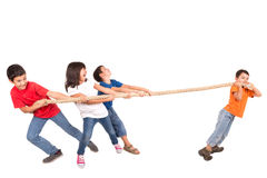 Rope pulling. Group of children in a rope-pulling contest against just one kid Royalty Free Stock Images