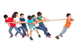 Rope pulling. Group of children in a rope-pulling contest against just one kid Royalty Free Stock Photography