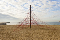 Rope pyramid playground in the beach Royalty Free Stock Photo