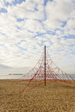 Rope pyramid playground in the beach Stock Image