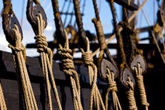 Rope Rigging on a Wooden Boat. Several sets of rope rigging on an old clipper ship stock image