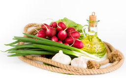 Rope ring and greens in the middle. A rope ring and olive oil with greens in the middle of it Royalty Free Stock Photo