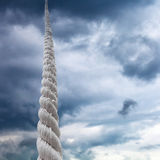 Rope rises to sky with storm clouds Royalty Free Stock Image
