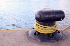 Rope rotated around pole. Royalty Free Stock Photo