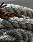 Rope and rusty chain ocean in the background stock image