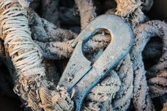 Rope and rusty hook Royalty Free Stock Photo