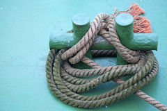 A rope securing a boat on the dock, Belgium. A rope tied off to secure a boat to the Dock, Belgium Stock Images