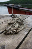Rope securing canoe to dock Royalty Free Stock Images