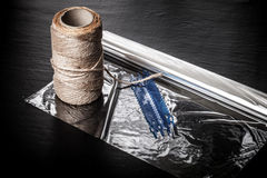 Rope and set for roasting meat on a black background. Toned Royalty Free Stock Photo