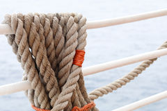Rope on ship`s rail. Rope tied around the rail on the deck of a ship stock image