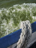Rope on ship side  and water Stock Photos