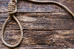 Rope with a slipknot. On the wooden background Stock Photo