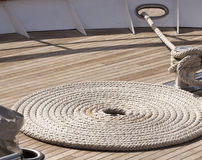 Rope in spiral form on ship deck Royalty Free Stock Photo
