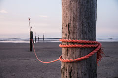 Rope on stake Stock Photo