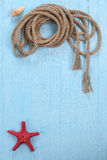 Rope  starfish on blue  background Stock Photography