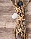 Rope, starfish, sea stones Stock Images