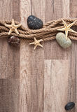 Rope, starfish, sea stones Royalty Free Stock Photo