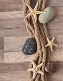 Rope, starfish, sea stones Stock Photo