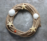 Rope and starfish. Summer concept with rope and starfish on a concrete background.Top view. Copy space Stock Photography