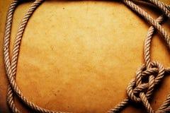 Rope sur le vieux papier Images libres de droits