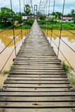 Rope suspension bridge across a river, Thailand Stock Photography