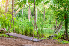 rope swing in the garden with canal at countryside Royalty Free Stock Photography