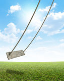 Rope Swing On Green Field Royalty Free Stock Photography