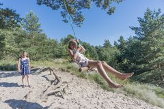 Rope swing play Royalty Free Stock Photos