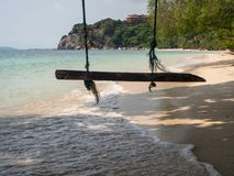 Rope swing by the sea royalty free stock images