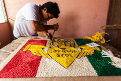 Rope tapestry craftsman works on rug Stock Images