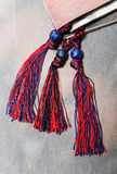 Rope with tassels. Royalty Free Stock Image
