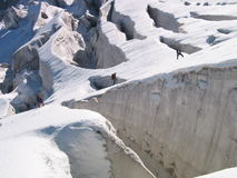 Rope team in front of glacier crevasses Royalty Free Stock Photos