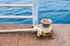 Rope thick tied with steel pier for boat Royalty Free Stock Images