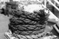 Rope tie. Black and White rope tie at harbor Royalty Free Stock Photography