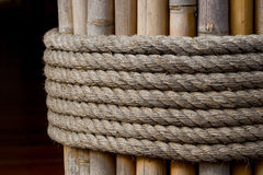 Rope tie on bamboo Stock Photo