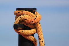 Rope tied around a large post Stock Image