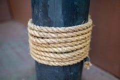 Rope tied around the mast on a retro sailboat stock image