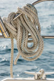 A rope tied around a rail on a yacht Royalty Free Stock Image