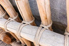 Rope tied around wooden fence pole Stock Image